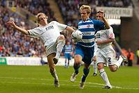 Photo: Alan Crowhurst.<br />Reading v Leeds Utd. Coca Cola Championship.<br />29/10/2005. Reading's Kevin Doyle (R) challenges Matthew Kilgallon.