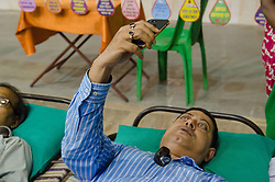 August 16, 2017 - Kolkata, West Bengal, India - A blood donor taking selfie on the bed (Credit Image: © Avijit Ghosh/Pacific Press via ZUMA Wire)