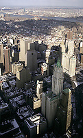 """The long shadow of the World Trade Center twin towers is projected onto lower Manhattan and the Woolworth building. Both of these buildings were """"world's tallest's"""" upon completion."""
