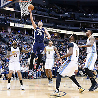 01 February 2016: Memphis Grizzlies forward Chandler Parsons (25) goes for the layup between Denver Nuggets forward Wilson Chandler (21), Denver Nuggets guard Gary Harris (14), Denver Nuggets guard Emmanuel Mudiay (0) and Denver Nuggets forward Darrell Arthur (00) during the Memphis Grizzlies 119-99 victory over the Denver Nuggets, at the Pepsi Center, Denver, Colorado, USA.