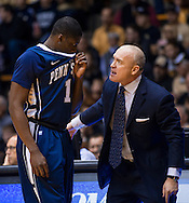 WEST LAFAYETTE, IN - JANUARY 13: Head coach Patrick Chambers of the Penn State Nittany Lions talks to Akosa Maduegbunam #1 of the Penn State Nittany Lions on the sidelines against the Purdue Boilermakers at Mackey Arena on January 13, 2013 in West Lafayette, Indiana. (Photo by Michael Hickey/Getty Images) *** Local Caption *** Patrick Chambers; Akosa Maduegbunam