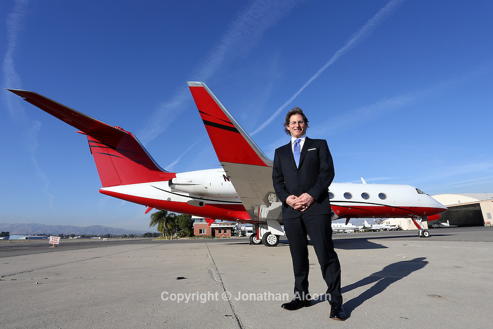 January 29, 2014 Van Nuys, CA   Greg Raiff, Chief Executive Officer; Private Jet Services, stands on the tarmac at Van Nuys Airport with a private jet that will be used to fly passengers to the Super Bowl this weekend.<br /> photo by Jonathan Alcorn for The Boston Globe