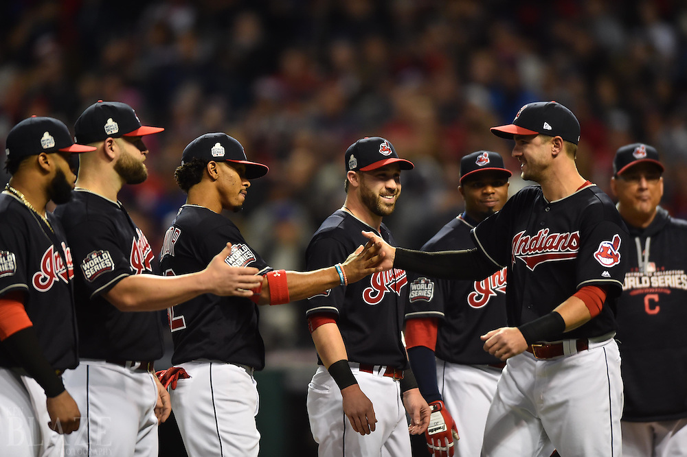 Oct 25, 2016; Cleveland, OH, USA; Cleveland Indians right fielder Lonnie Chisenhall (right) is greeted by teammates including Francisco Lindor before game one of the 2016 World Series against the Chicago Cubs at Progressive Field. Mandatory Credit: Ken Blaze-USA TODAY Sports