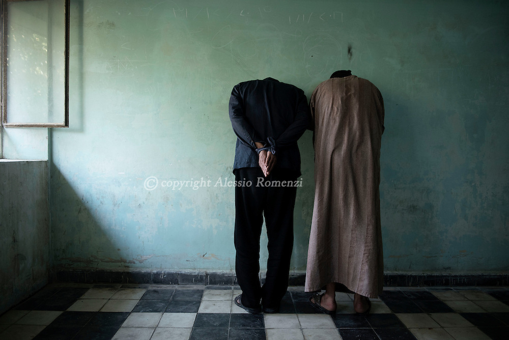 Iraq, Kirkuk: Prisoners accused of being ISIS members stand facing the wall inside one of the facilities of the prison in Kirkuk. Alessio Romenzi