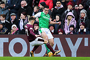 Harry Cochrane (#47) of Heart of Midlothian slides in to win the ball from John McGinn (#7) of Hibernian during the William Hill Scottish Cup 4th round match between Heart of Midlothian and Hibernian at Tynecastle Stadium, Gorgie, Scotland on 21 January 2018. Photo by Craig Doyle.