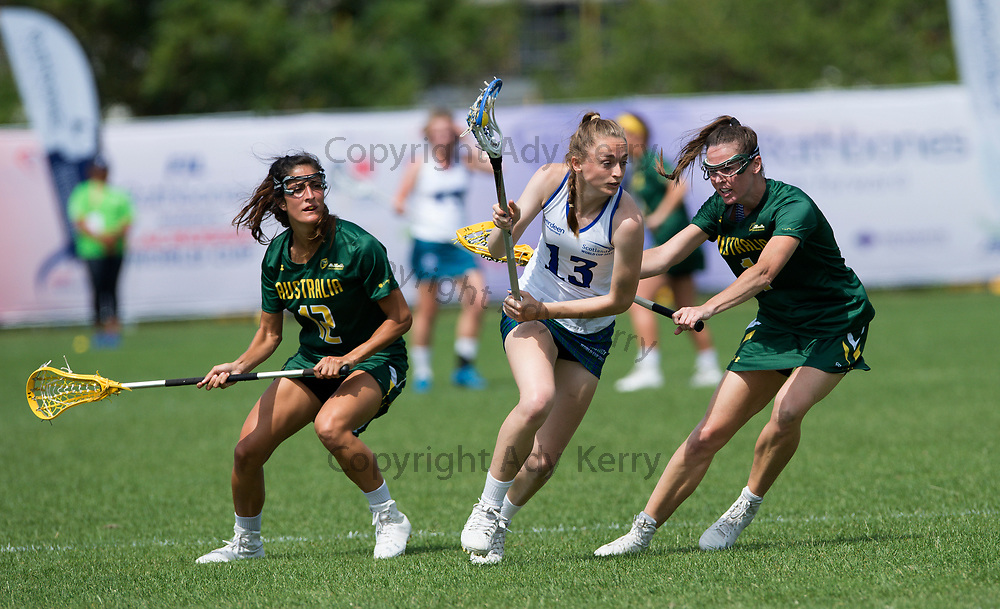 Scotland's  Georgie Greenwood challenges with Australia's Abbie Burgess at the 2017 FIL Rathbones Women's Lacrosse World Cup, at Surrey Sports Park, Guildford, Surrey, UK, 18th July 2017.