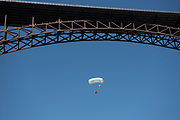 """Miles Daisher, professional base jumper, jumping from the Perrine Bridge with """"Twin Falls"""" parachute in the Snake River Canyon, Twin Falls, Idaho. MR"""