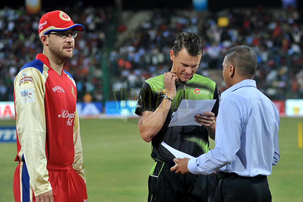Daniel Vettori of Royal Challengers Bangalore and Johan Botha of Warriors during the toss before the start of the match 1 of the NOKIA Champions League T20 ( CLT20 )between the Royal Challengers Bangalore and the Warriors held at the  M.Chinnaswamy Stadium in Bangalore , Karnataka, India on the 23rd September 2011..Photo by Pal Pillai/BCCI/SPORTZPICS