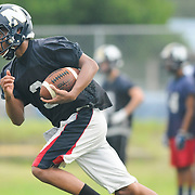 Tiger Bryant of North Brunswick High School football team practices at the school Friday August 1, 2014. (Jason A. Frizzelle)