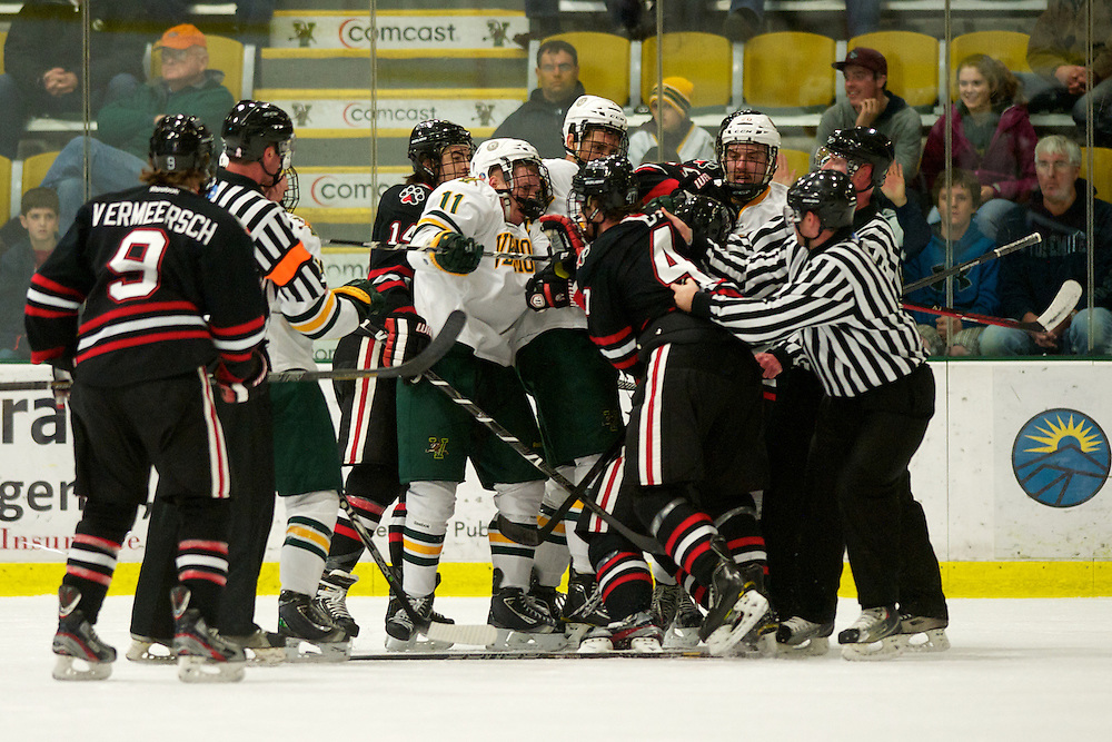 The Catamounts and the Huskies scuffle after the whistle during the mens hockey game between the Northeastern Huskies and the Vermont Catamounts at Gutterson Field House on Sunday night November 18, 2012 in Burlington, Vermont.
