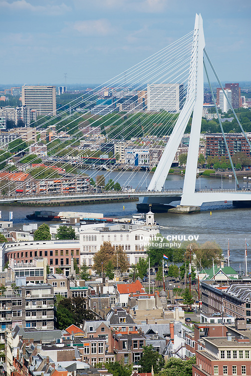 ROTTERDAM, NETHERLANDS - JUNE 02, 2013: Aerial view to Erasmus bridge and modern buildings of the city of Rotterdam, Netherlands.