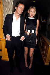 The HON.SOPHIA HESKETH and ROBIE UNIACKE at a dinner hosted by fashion label Issa at Annabel's, Berekely Square, London on 24th April 2007.<br />