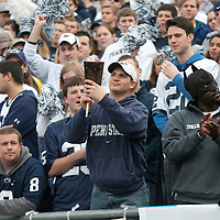 A Penn State fan plays the cowbell during warm ups prior to a game against the Illinois Fighting Illini on November 2, 2013 at Beaver Stadium in University Park, Pennsylvania.