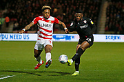 A cross from Barnsley forward Mamadou Thiam (26) is blocked by Mallik Wilks of Doncaster Rovers  during the EFL Sky Bet League 1 match between Doncaster Rovers and Barnsley at the Keepmoat Stadium, Doncaster, England on 15 March 2019.