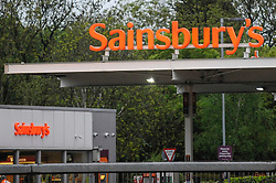 © Licensed to London News Pictures. 28/04/2018. LONDON, UK.  Signage for an Sainsbury's superstore is seen in Watford, north west London.   ASDA and Sainsbury's are reported to be in negotiations for a GBP10m merger to create combined group of 2,800 stores representing over 30% of the UK grocery market.  Photo credit: Stephen Chung/LNP