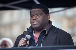 © Licensed to London News Pictures. 19/03/2016. London, UK.  Journalist Gary Younge speaks to demonstrators in Trafalgar Square. Thousands march through central London on UN anti-racism day to demand that the British government accept a greater share of refugees seeking asylum in Europe. Photo credit : Rob Pinney/LNP