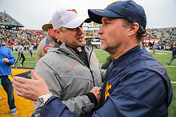 Nov 18, 2017; Morgantown, WV, USA; Texas Longhorns head coach Tom Herman talks with West Virginia Mountaineers head coach Dana Holgorsen after the game at Milan Puskar Stadium. Mandatory Credit: Ben Queen-USA TODAY Sports