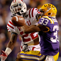 November 12, 2011; Baton Rouge, LA, USA;  Western Kentucky Hilltoppers defensive back Tyree Robinson (22) breaks up a pass intended for LSU Tigers wide receiver Odell Beckham (33) during the second quarter of a game at Tiger Stadium.  Mandatory Credit: Derick E. Hingle-US PRESSWIRE