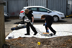 © Licensed to London News Pictures. 16/05/2017. London, UK. A Police search team use a scanner on the ground. Police continue to search for the body of murdered schoolgirl Danielle Jones at a block of garages  in Stifford Clays in Thurrock, Essex. The 15-year-old was last seen on Monday June 18 2001 at about 8am when she left her home in East Tilbury to catch the bus to school.  Photo credit: Ben Cawthra/LNP