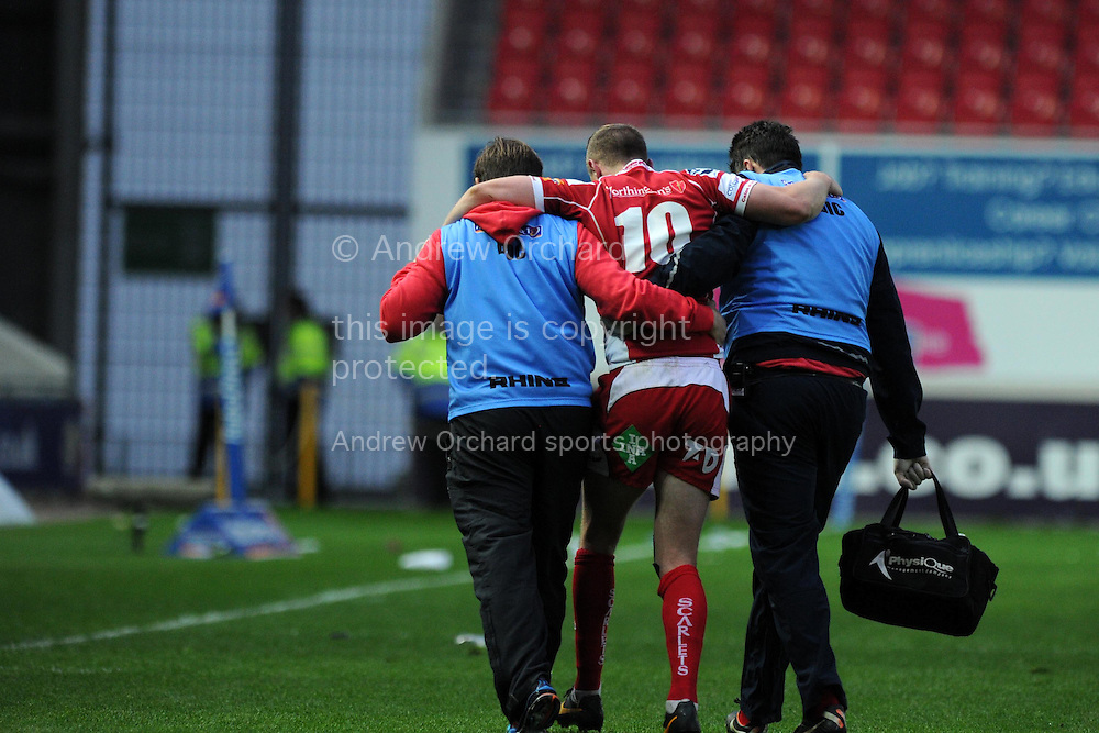 Rhys Priestland of the Scarlets leaves the field with an injury. Rabodirect Pro12 rugby union match, Scarlets v Cardiff Blues at Parc y Scarlets in Llanelli, South Wales on Sat 10th May 2014.<br /> pic by Andrew Orchard, Andrew Orchard sports photography.