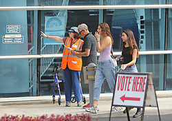 A poll worker helps voters outside the Aventura City Hall during the midterm elections in Miami-Dade County on Tuesday, November 6, 2018. Photo by David Santiago/Miami Herald/TNS/ABACAPRESS.COM