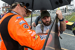 October 5, 2018 - Dover, DE, U.S. - DOVER, DE - OCTOBER 05: Kevin Harvick driver of the #4 Busch Outdoors Ford signs a windshield for a fans after qualifying for the Monster Energy NASCAR Cup Series Gander Outdoors 400 was canceled on October 05, 2018, at Dover International Speedway in Dover, DE. (Photo by David Hahn/Icon Sportswire) (Credit Image: © David Hahn/Icon SMI via ZUMA Press)