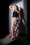 Houston model Rachael Campbell modeling black midriff and floral slit dress in shadow frame studio photo.
