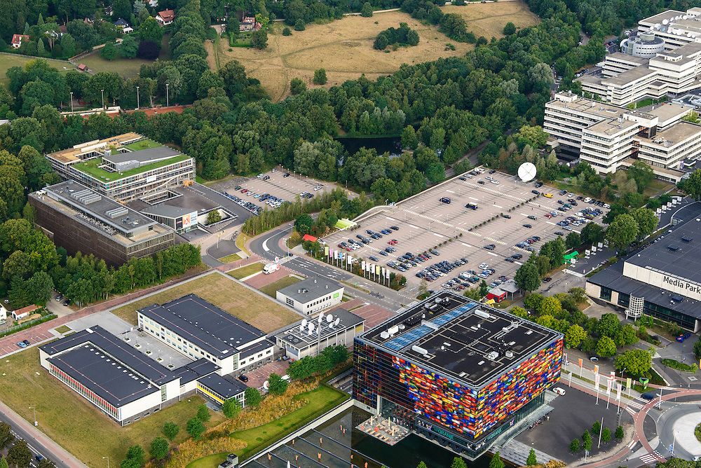 Nederland, Noord-Holland, Hilversum, 27-08-2013; Mediapark met Instituut voor Beeld en Geluid (li), VPRO-gebouw en dat van NTR-Vara. <br /> Business park of the public and commercial broadcasting companies,  the VPRO (green roof) and NTR-Vara buildings and the Netherlands Institute for Sound and Vision.<br /> luchtfoto (toeslag op standaard tarieven);<br /> aerial photo (additional fee required);<br /> copyright foto/photo Siebe Swart.