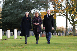 Prime Minister Theresa May (left) walks at the St Symphorien Military Cemetery in Mons, Belgium, with Belgian Prime Minister Charles Michel and Liz Sweet, Director, External Relations, Western Europe Area, Commonwealth War Graves Commission.