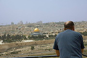 Israel, Jerusalem Old City, tourist looking at The Dome of the Rock at Haram esh Sharif the Noble Sanctuary and the old city as seen from the Zeevi observation point on mount Olives