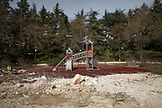 The abandoned playground of the neighborhood called Villa where 200 people died for the earthquake. On 6 April 2009 a strong earthquake hit the city of L'Aquila, in the central Abruzzo region of Italy, leaving 308 dead and tens of thousand homeless. 4  years after In the historical center of the city few signs of reconstructions could be seen. On the other hand the effects of the of abandonment add up to the destruction of the quake. .