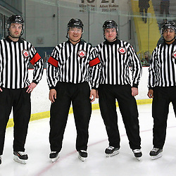 Georgetown, ON  - MAR 31,  2018: Ontario Junior Hockey League, South West Conference Championship Series. Game two of the best of seven series between the  Toronto Patriots and the Georgetown Raiders. The Officiating Crew for game two of the series , Referee Tyson Orlie and Ryan Park. Linesman Kyle Pessoa and Zalman Estrange.<br /> (Photo by Tim Bates / OJHL Images)