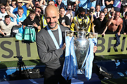 File photo dated 12-05-2019 of Manchester City manager Pep Guardiola celebrates with the trophy after the match