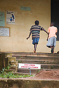 Signs in a Ugandan schoolyard highlight the government's successful grassroots campaign in educating its people about AIDS.