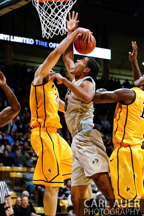 November 13th, 2013:  Colorado Buffaloes sophomore forward Josh Scott (40) has his shot blocked in the first half of action in the NCAA Basketball game between the University of Wyoming Cowboys and the University of Colorado Buffaloes at the Coors Events Center in Boulder, Colorado