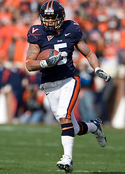 Virginia tight end Mikell Simpson (5) rushes for a touchdown against VT.  The #8 ranked Virginia Tech Hokies defeated the #16 ranked Virginia Cavaliers 33-21 at Scott Stadium in Charlottesville, VA on November 24, 2007.