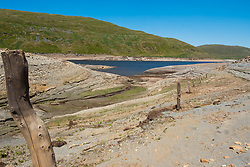 &copy; Licenced to London News Pictures<br /> <br /> Nant y Moch, Ceredigion, Wales UK, 02 July 2018<br /> <br /> UK Weather: After a very long dry and hot spell of weather,  the reservoir at Nant y Moch, just inland of Aberystwyth, has fallen to dramatically low levels last seen in the long hot summer of 1976. <br /> Already, some local properties the nearly village of Ponterwyd, , that draw their water from  wells and springs, have seen their water supplies dry up and disappear <br /> <br /> photo credit Keith Morris / LNP