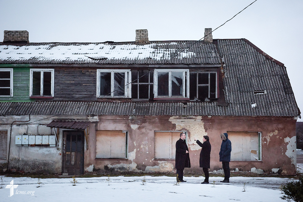 The Rev. Mindaugas Kairys (arm raised) of the Evangelical Lutheran Church in Lithuania talks to Bishop Mindaugas Sabutis outside a vacant building planned for renovation into a treatment center for addicts on Friday, Feb. 6, 2015, in Garliava, Lithuania. LCMS Communications/Erik M. Lunsford
