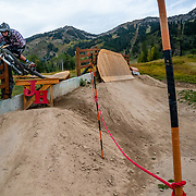 Kyle Dowman rides the lift accessed trails and features of Jackson Hole Mountain Resort in Teton Village, Wyoming.