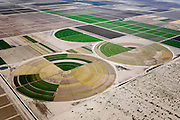 Central pivot irrigation systems were developed in the United States in the 1950s.  Since then, irrigated land in the U.S. has more than doubled.  Central pivot irrigators are being put to heavy use in the Southwest, where their design is well-suited to the flat topography and large-scale agricultural plots.
