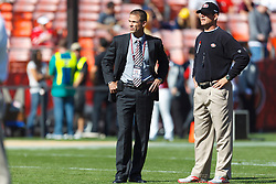 Oct 30, 2011; San Francisco, CA, USA; San Francisco 49ers general manager Trent Baalke (left) talks with head coach Jim Harbaugh (right) before the game against the Cleveland Browns at Candlestick Park. San Francisco defeated Cleveland 20-10. Mandatory Credit: Jason O. Watson-US PRESSWIRE
