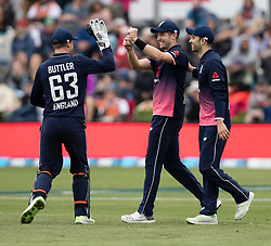England's Chris Woakes, centre, celebrates with Jos Buttler and Mark Wood after catching New Zealand's Colin de Grandhomme out in the fourth one day cricket international at the University of Otago Oval, Dunedin, New Zealand, Wednesday, March 7, 2018. Credit:SNPA / Adam Binns ** NO ARCHIVING**