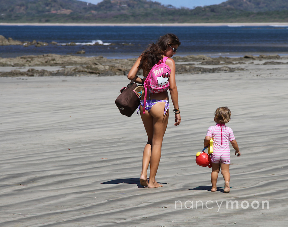 Costa Rica woman and child on beach.<br />