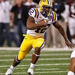 Jan 7, 2011; Arlington, TX, USA; LSU Tigers running back Michael Ford (42) runs against the Texas A&M Aggies during the second quarter of the 2011 Cotton Bowl at Cowboys Stadium.  Mandatory Credit: Derick E. Hingle
