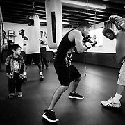 Bantam weight world champion boxer Abner Mares is worked out by trainer Clemente Medina at the Maywood Boxing Club in Los Angeles.