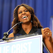 "First Lady Michelle Obama appeared at the grassroots ""Commit to Vote"" rally for Democrat Charlie Crist who is running for Governor of the state of Florida. The campaign called on the event to "" energize voters and lay out the stakes for Floridians in the critical election on November 4th."" at the Barnett Park Gymnasium in Orlando, Florida on Friday, Nov. 17, 2014. (AP Photo/Alex Menendez)"