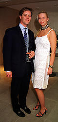 MR PETER THOMPSON twin brother of Lady Ivar Mountbatten and MISS SOPHIA BURRELL, at a party in London on 2nd November 1999.MYL 2
