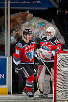 KELOWNA, CANADA - DECEMBER 3: Brodan Salmond #31 and Kole Lind #16 of the Kelowna Rockets share a laugh after pushing a loaded pick up truck off the ice after the annual teddy bear toss on December 3, 2016 at Prospera Place in Kelowna, British Columbia, Canada.  (Photo by Marissa Baecker/Shoot the Breeze)  *** Local Caption ***