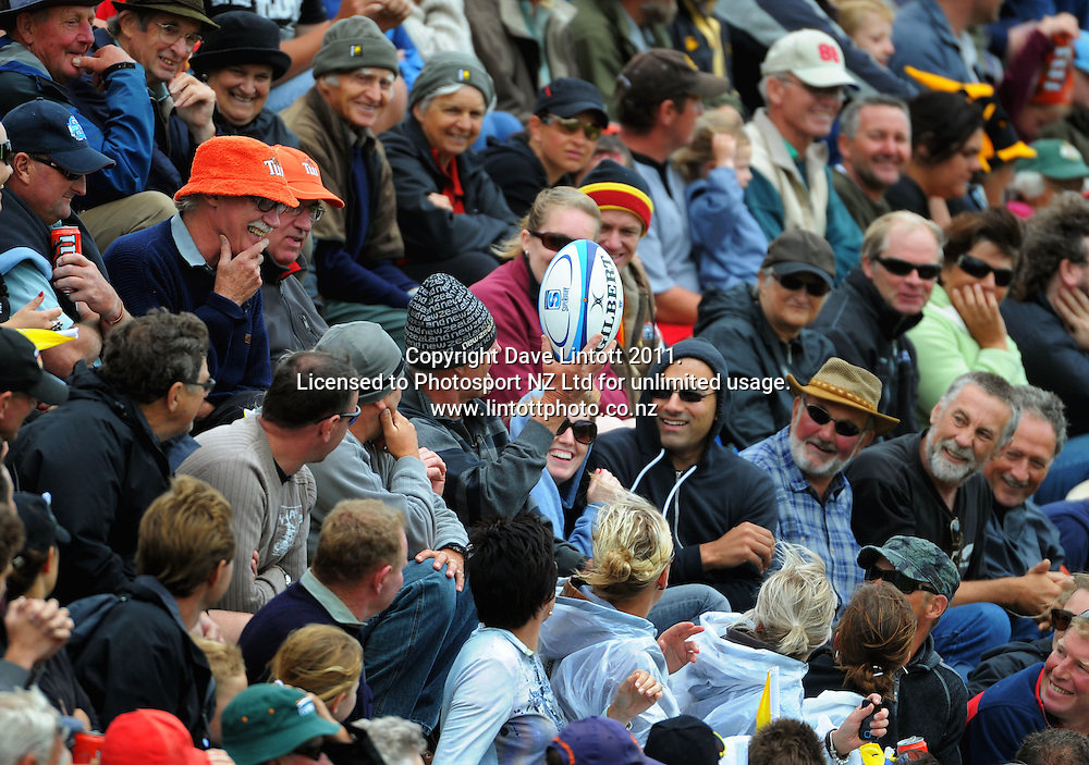 A spectator prepares to throw the match ball back. Super 15 rugby pre-season match - Hurricanes v Chiefs at Mangatainoka RFC, Mangatainoka, Wairarapa, New Zealand on Saturday, 29 January 2011. Photo: Dave Lintott / photosport.co.nz