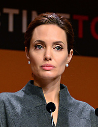 Image ©Licensed to i-Images Picture Agency. 13/06/2014. London, United Kingdom. In the frame - Angelina Jolie.<br /> John F. Kerry, Secretary of State of the United States of America; William Hague, UK Secretary of State for Foreign and Commonwealth Affairs; Angelina Jolie attend Global Summit to End Sexual Violence in Conflict, Excel London Exhibition Centre. Picture by Nils Jorgensen / i-Images